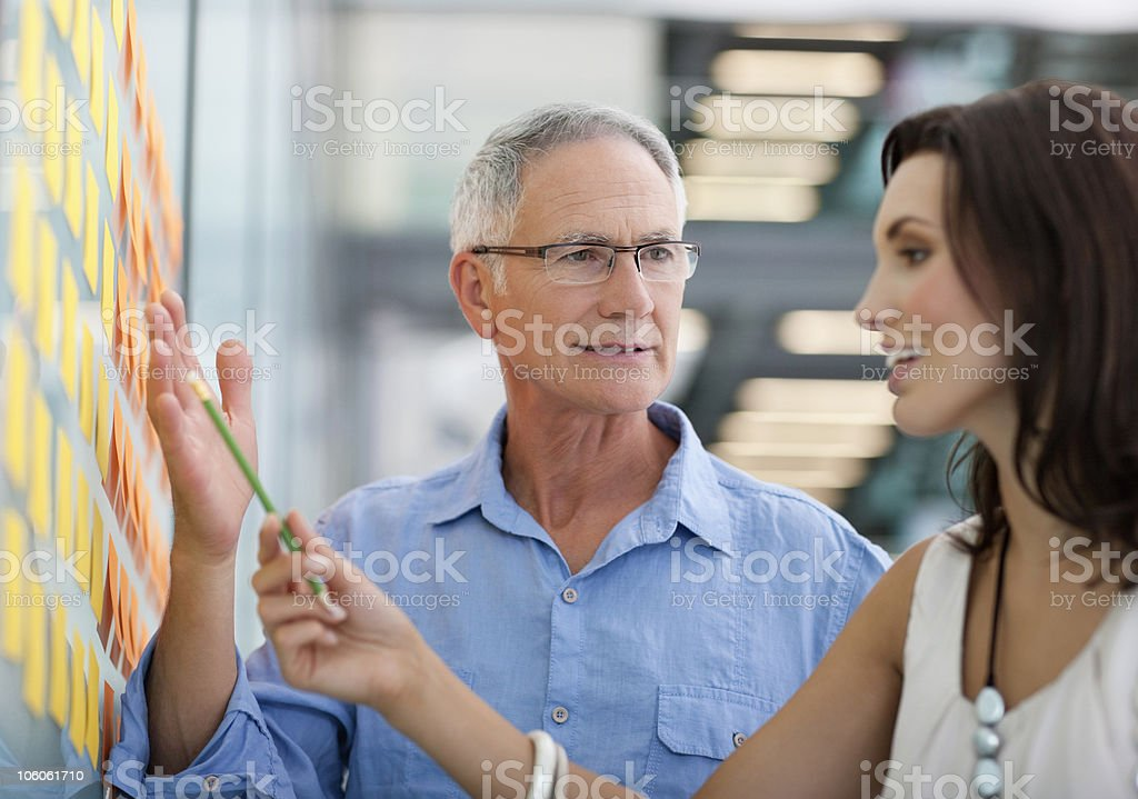 People discussing on planning schedule stock photo
