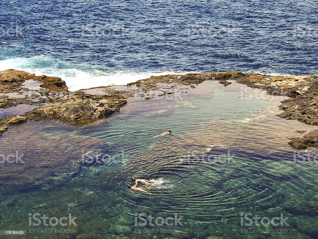 people diving in a natural basin royalty-free stock photo