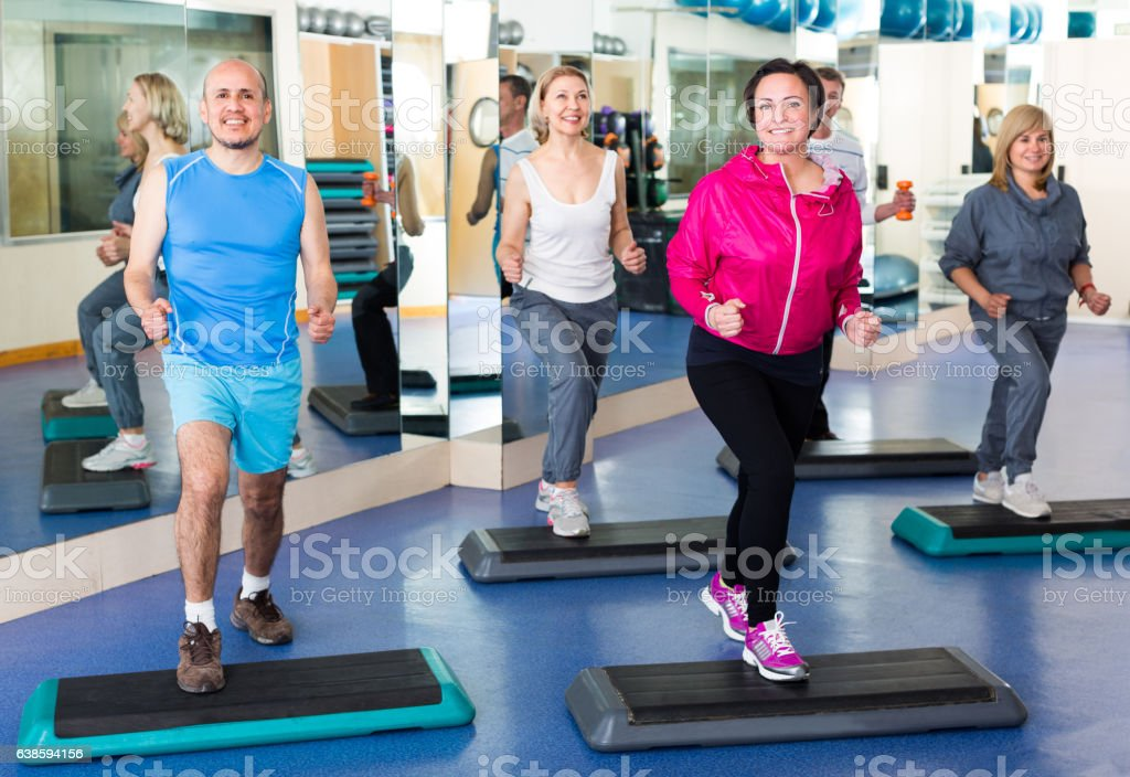 people do exercise in a fitness club stock photo