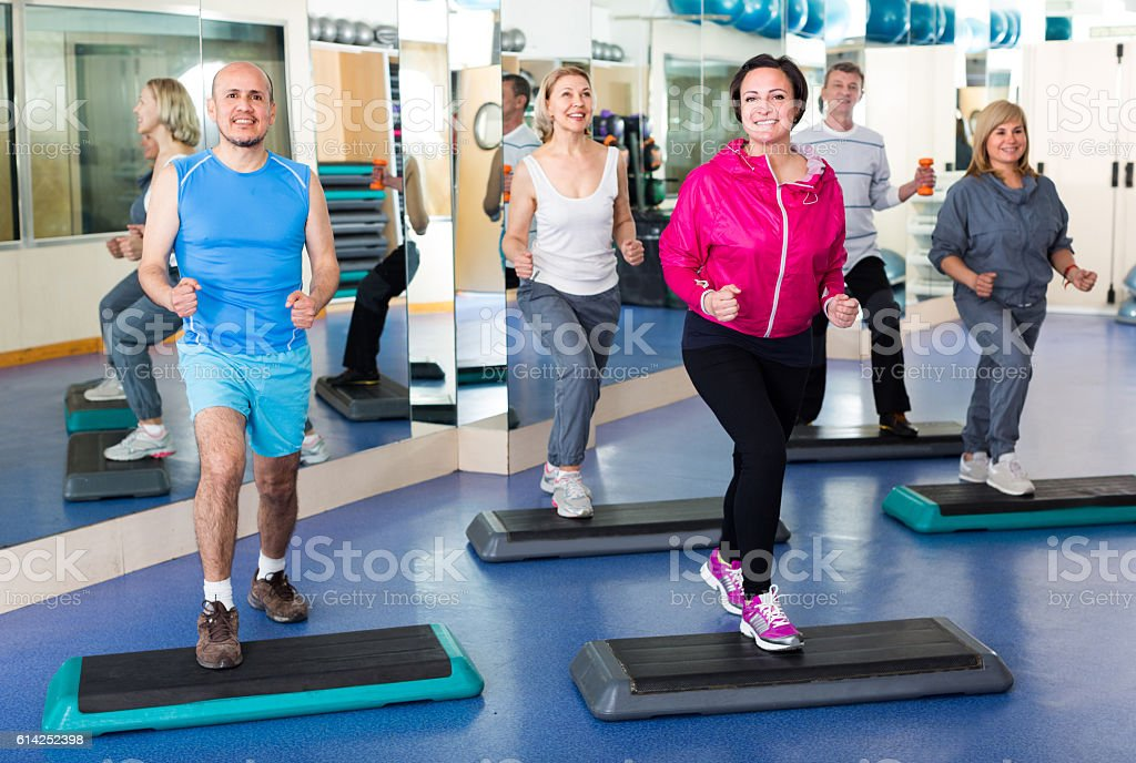 people do gym in a fitness club stock photo