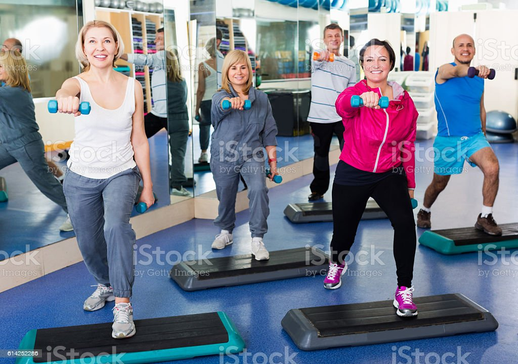 People do pilates with dumbbells stock photo