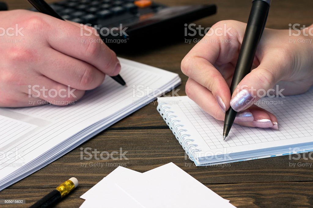 people do write in the notebook handles , telephone stock photo