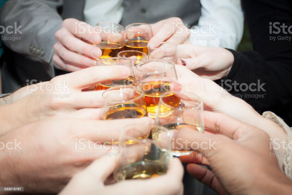 People Doing a Cheers for Shots stock photo