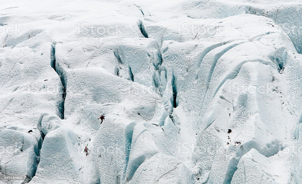 People doing ice climbing on a frozen glacier stock photo