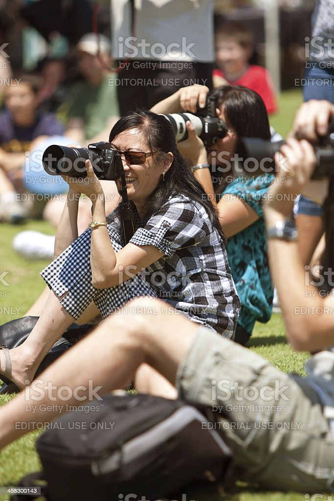 People Doing Photography At Outdoor Festival stock photo