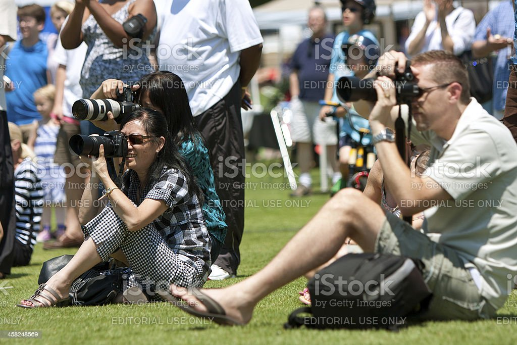 People Doing Photography At Spring Outdoor Festival stock photo