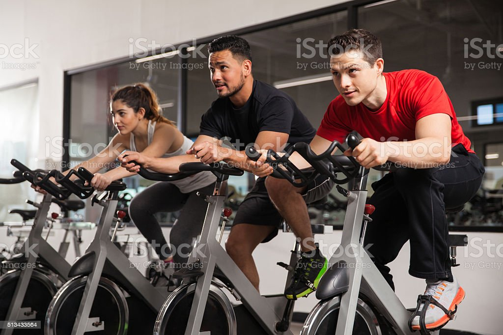 People doing some spinning at a gym stock photo