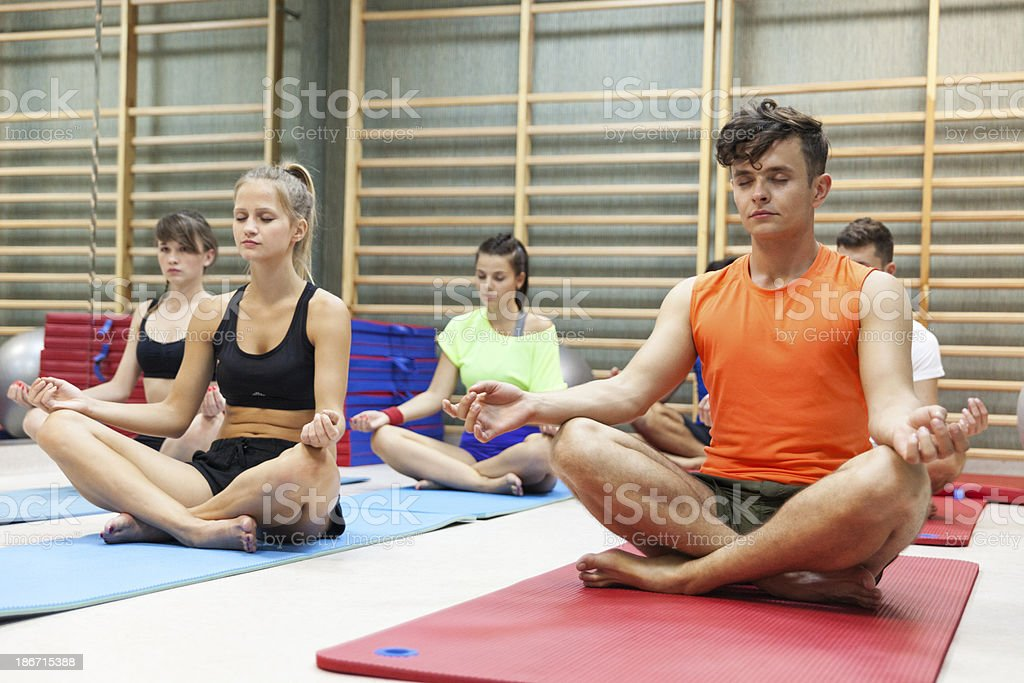 People Doing Yoga In Gym royalty-free stock photo