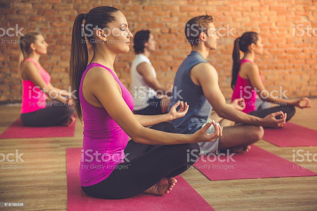 People doing yoga stock photo