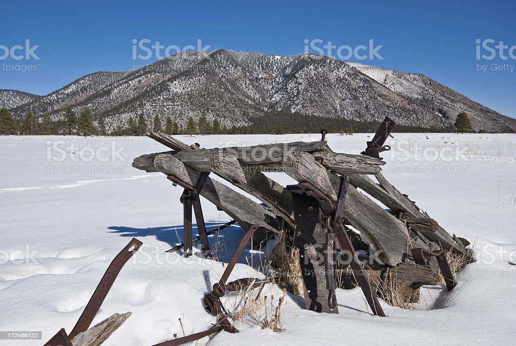 Wooden Farm Implement in the Snow royalty-free stock photo