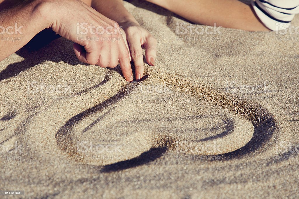 People drawing heart at sand. royalty-free stock photo
