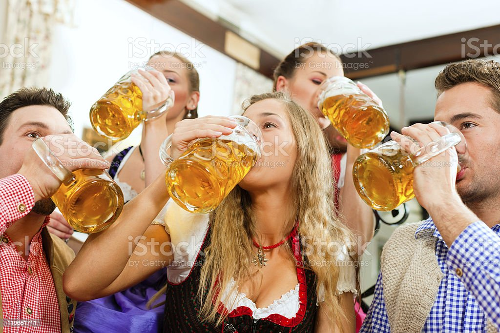 People drinking beer in Bavarian pub royalty-free stock photo