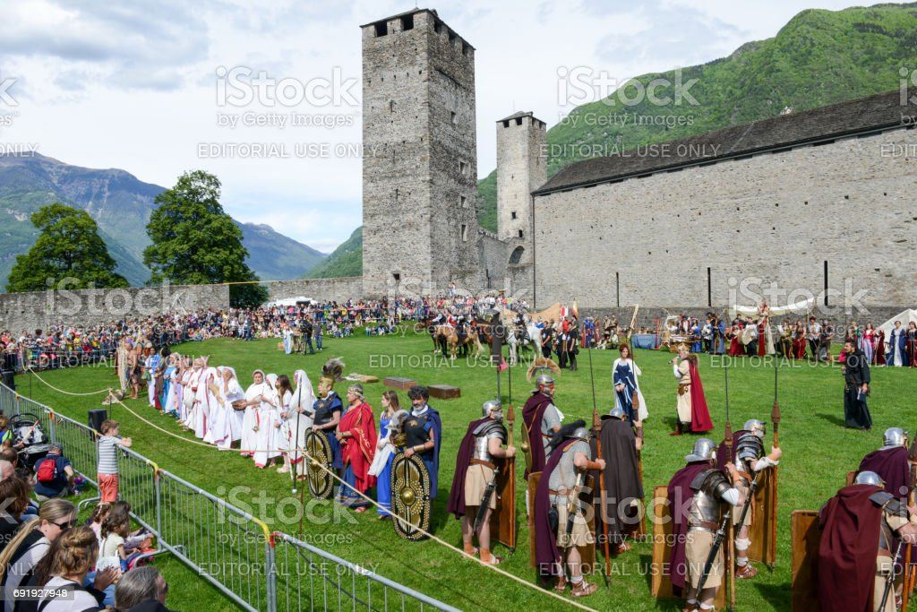 People during a parade of medieval characters on Castelgrande castle stock photo