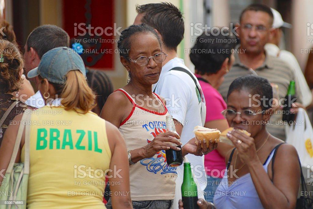 People eat local street fast food in Havana, Cuba. stock photo