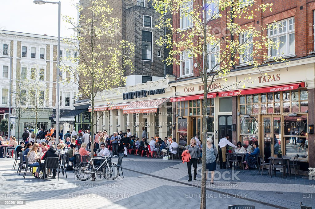 People eating and drinking on Exhibition Road, London stock photo