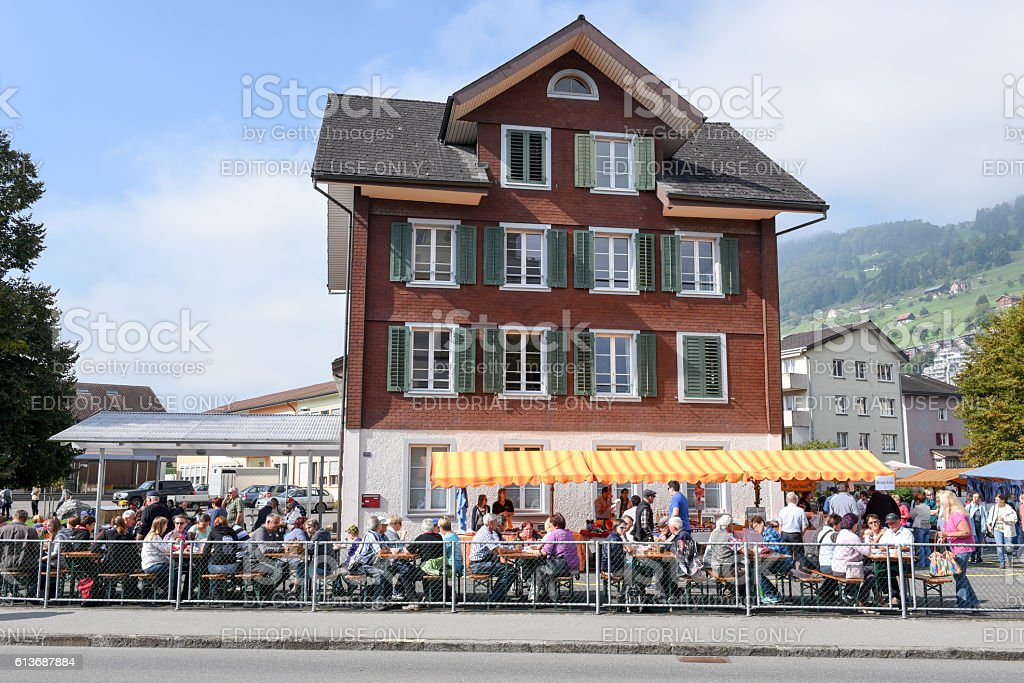 People eating and drinking on street restaurants at Ennetbuergen stock photo
