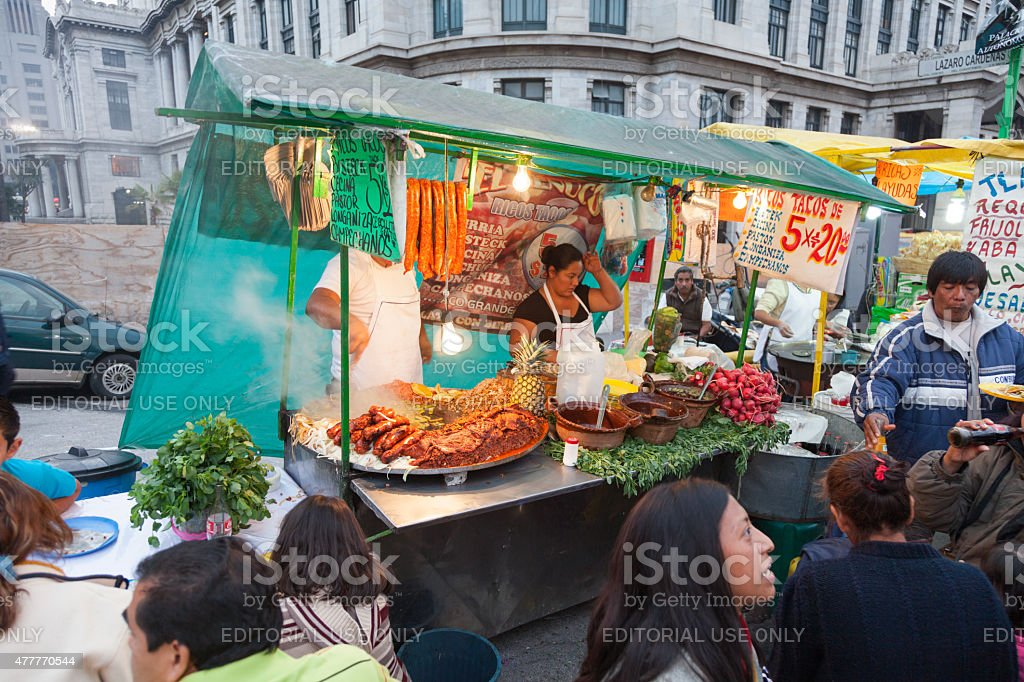 People eating and socializing at food market stall Mexico City stock photo