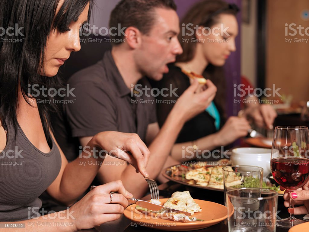 People eating at a restaurant royalty-free stock photo