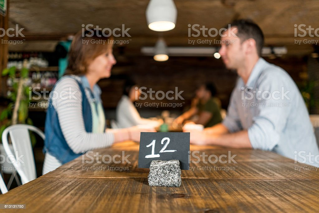 People eating at a restaurant stock photo