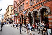 People eating at Starbucks coffee,Stockholm, Sweden