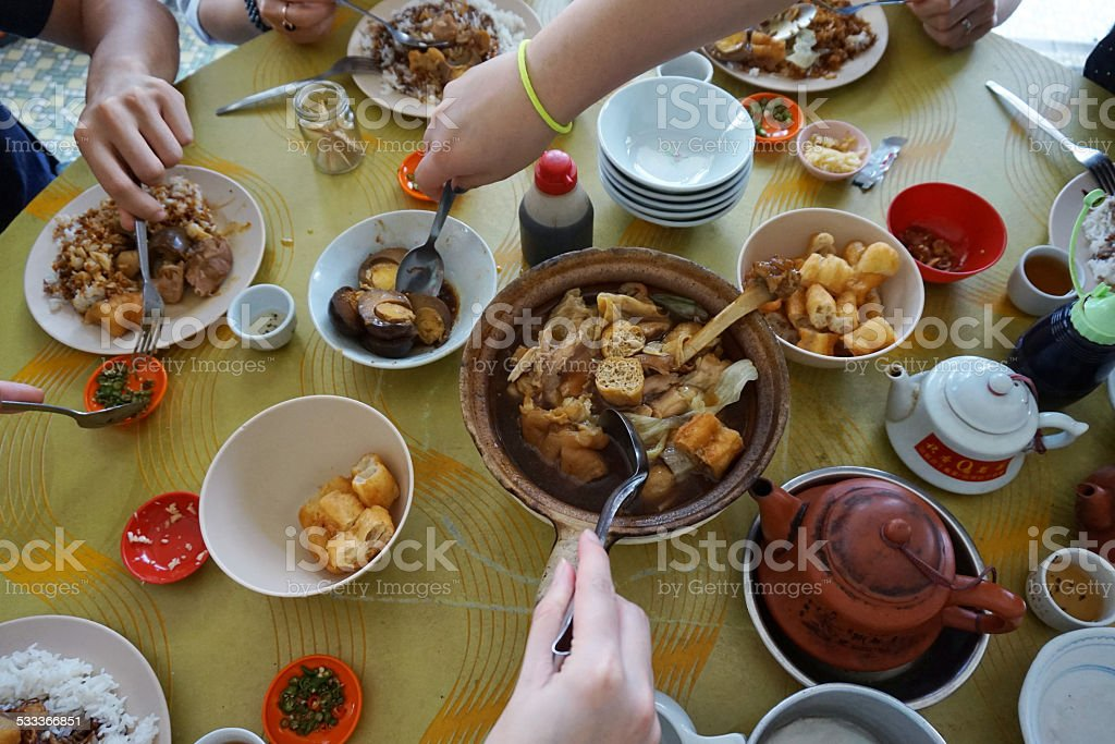 People eating at the table in Malaysia stock photo