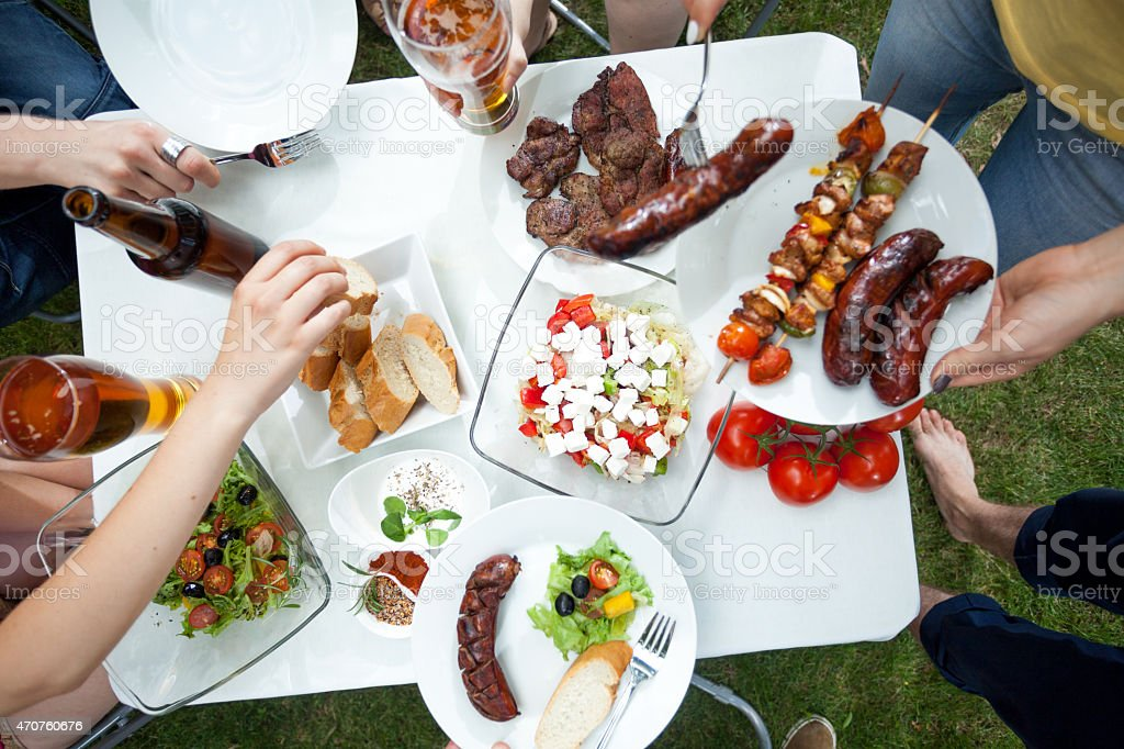 People eating grilled dishes stock photo