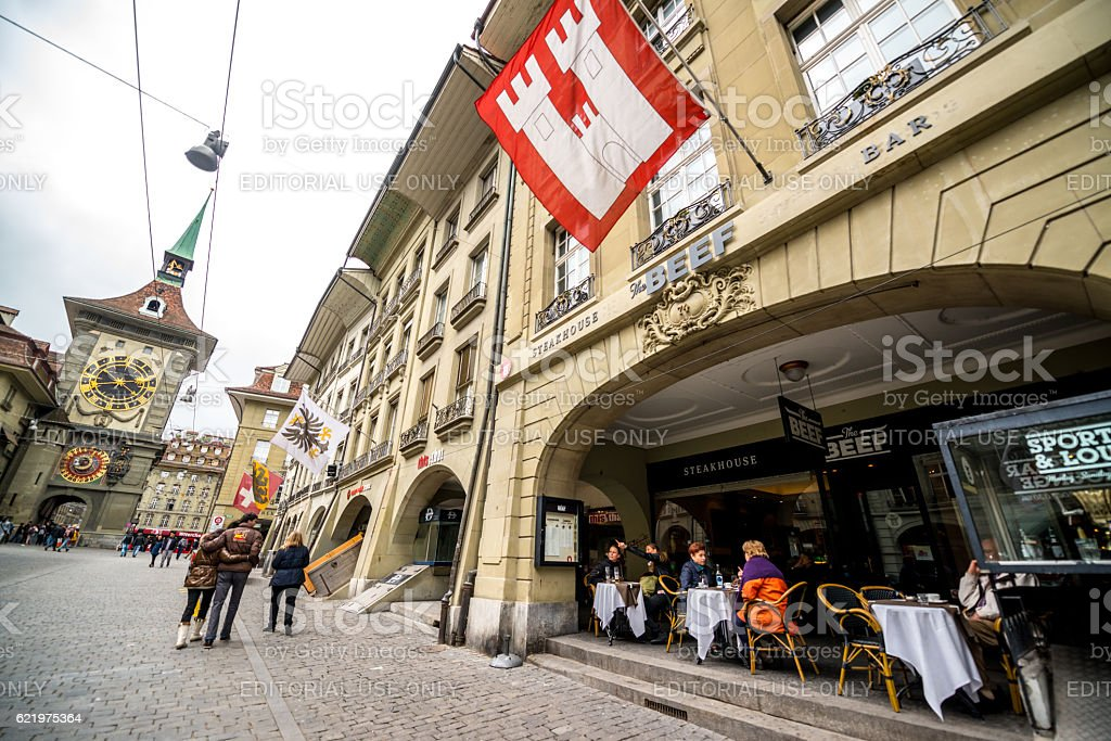 People eating in a steakhouse on Kramgrasse, Bern, Switzerland stock photo