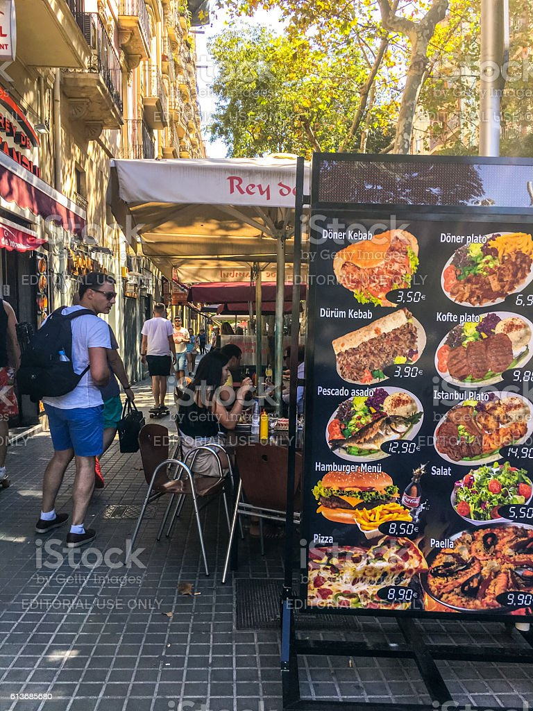 People eating in cafe, Barcelona stock photo