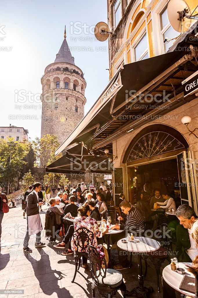 People eating in outdoor cafe near Galata Tower, Istanbul stock photo