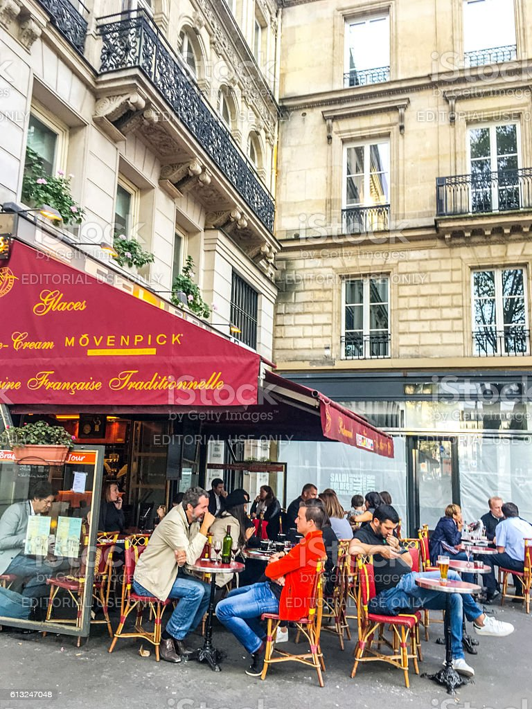 People eating in Paris cafe, France stock photo