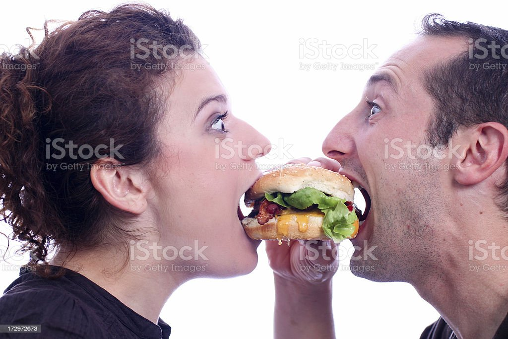 People eating juicy burger stock photo