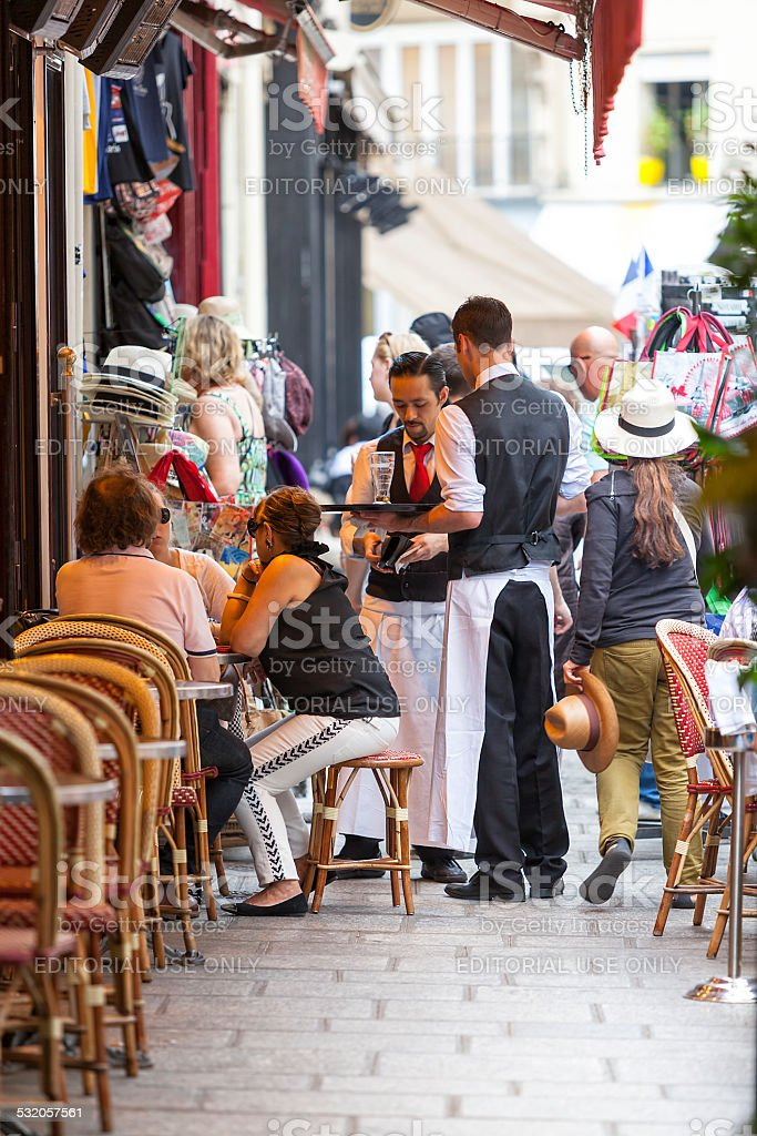 People Eating Lunch at a Street Restaurant in Paris, France stock photo