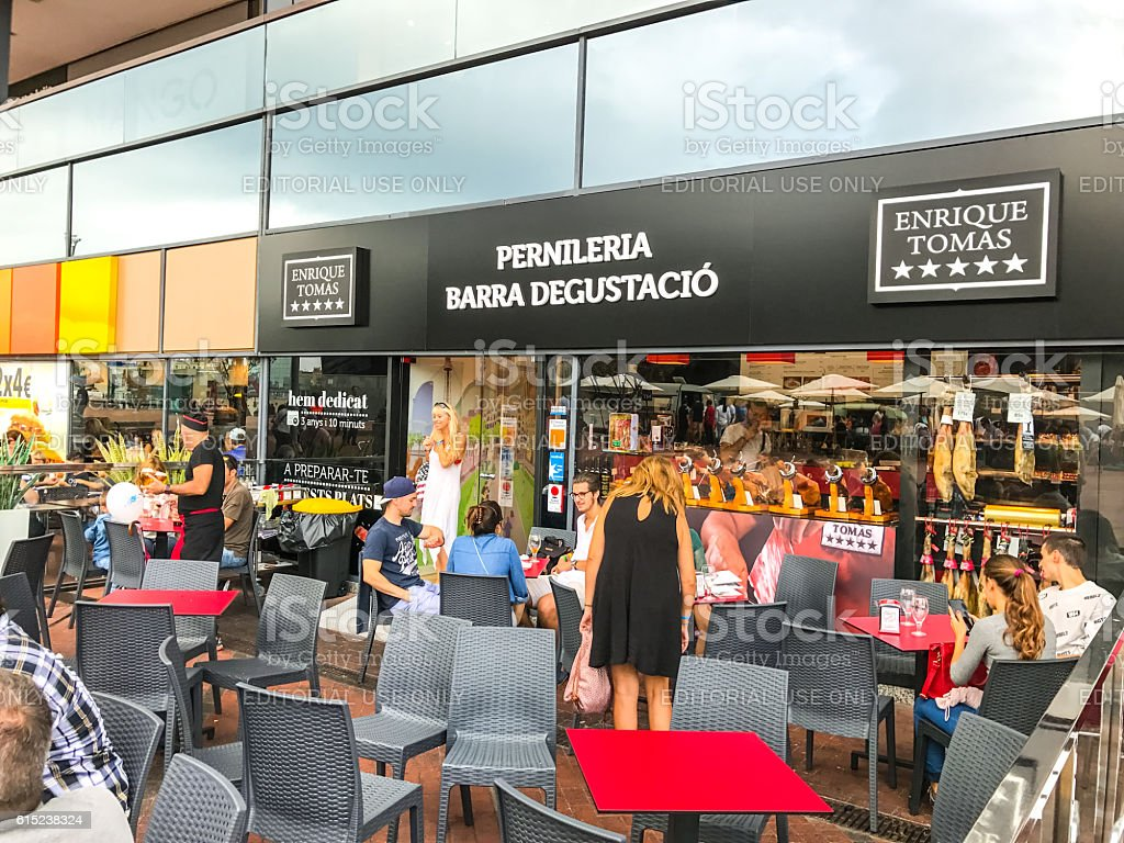 People eating outdoors at Maremagnum shopping mall,  Barcelona stock photo