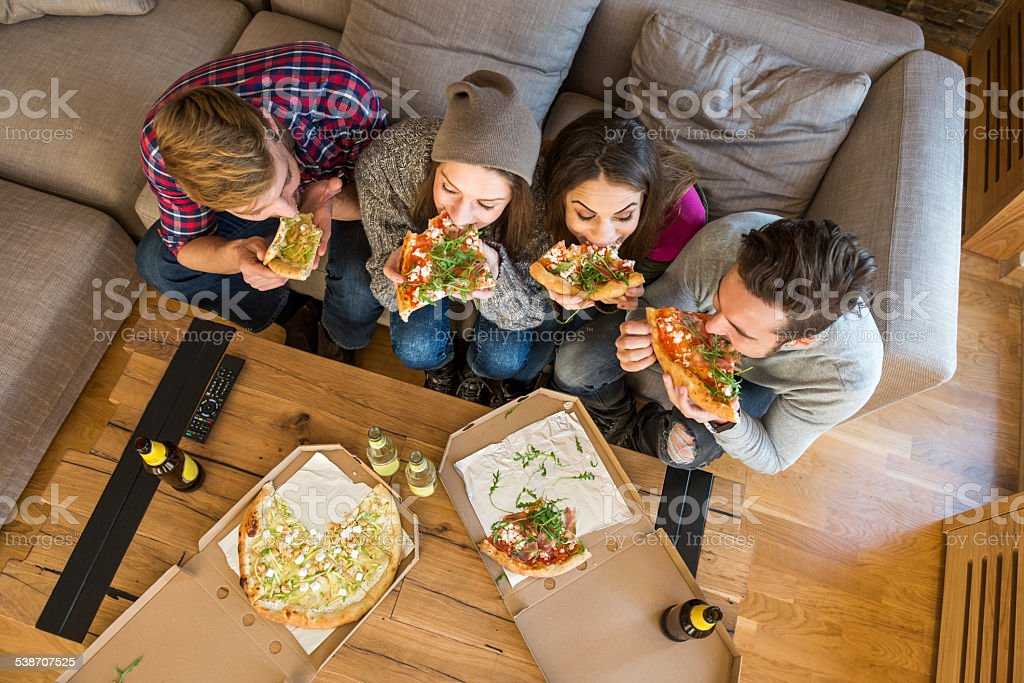 People eating pizza stock photo