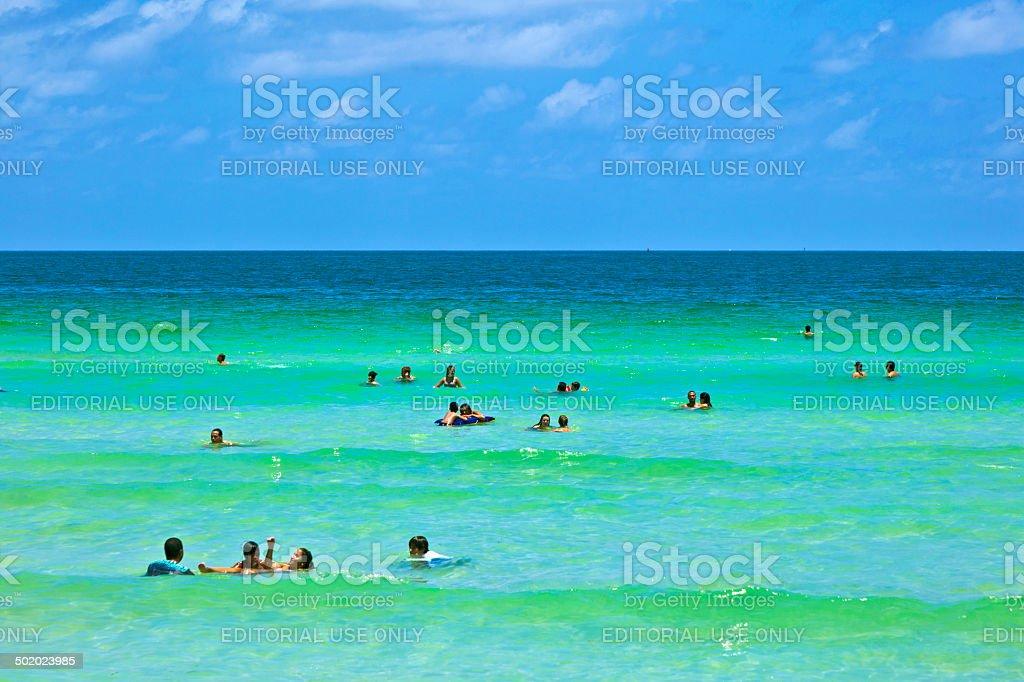 people enjoy  a beach in Miami stock photo
