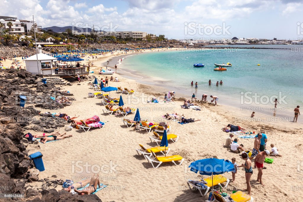 people enjoy a sunny day atn the beach  Playa Dorada stock photo