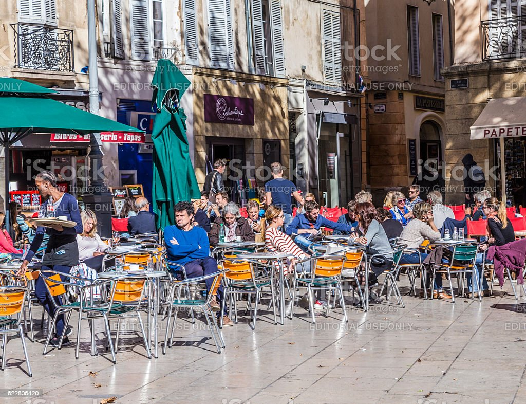 people enjoy a warm summer day in France stock photo