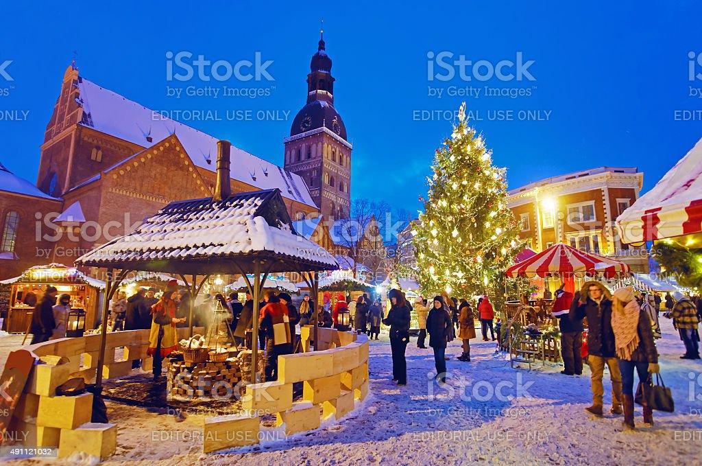 People enjoy Christmas market in Riga stock photo