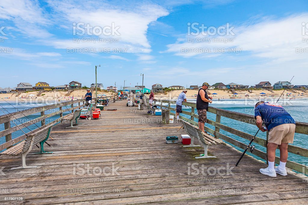 people enjoy fishing at the famous pier stock photo