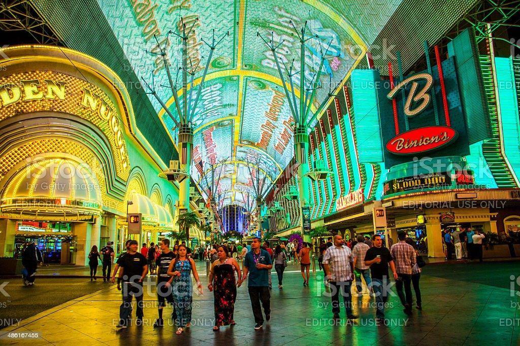 people enjoy Fremont Street in Las Vegas, Nevada by night stock photo