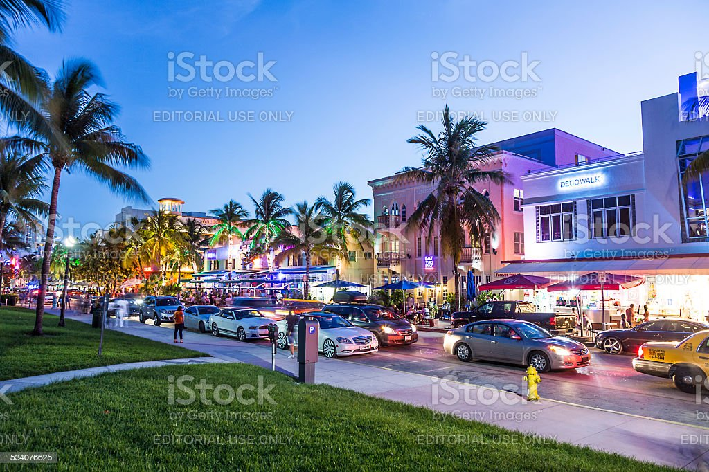 people enjoy Night view at Ocean drive  in Miami stock photo
