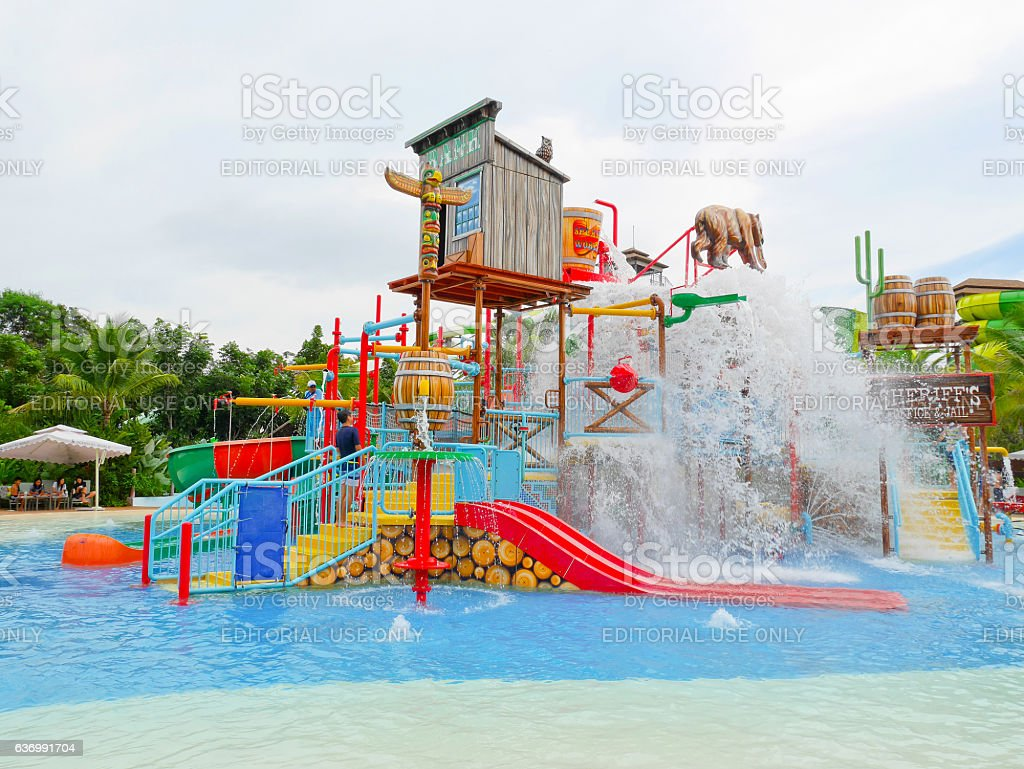 People enjoy playing at water park in Scenical World, Khaoyai stock photo
