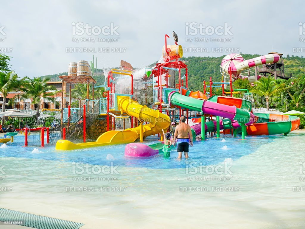 People enjoy playing at water park in Scenical World stock photo