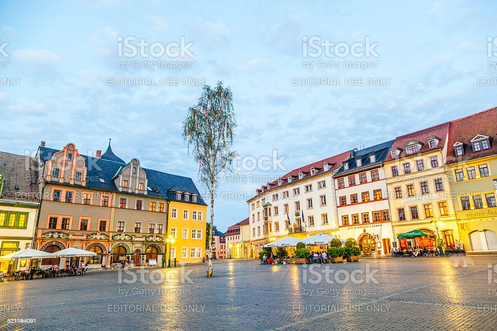 people enjoy sunset at central market place in Weimar stock photo