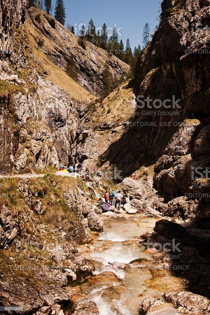 People enjoy sunshine above Höllental canyon in Bavaria stock photo
