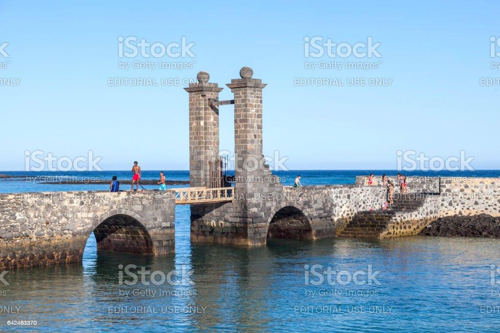 people enjoy swimming at castle Castillo de San Gabriel stock photo