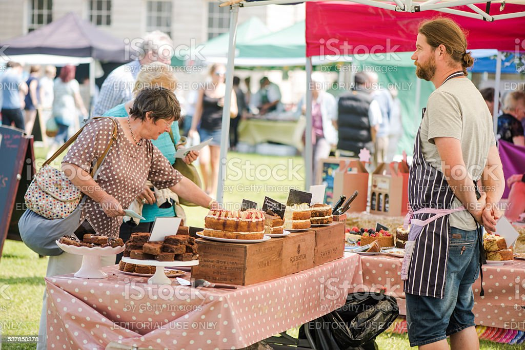 People enjoy tasting food at Good Food Sunday Market stock photo