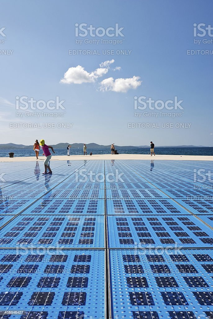People enjoy the afternoon on zadars solar panel installation stock photo