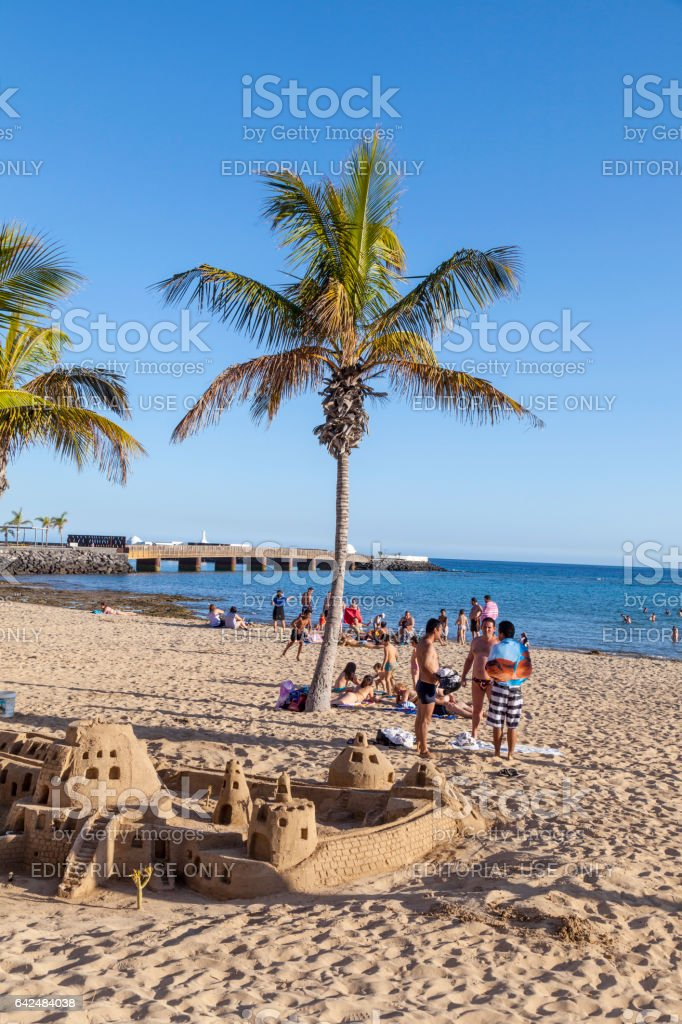 people enjoy the beach   and builf castles with sand stock photo