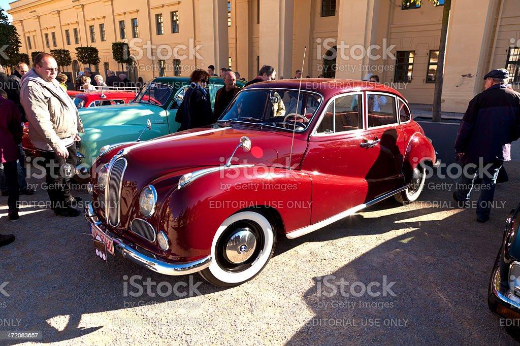 people enjoy the classic car BMW stock photo